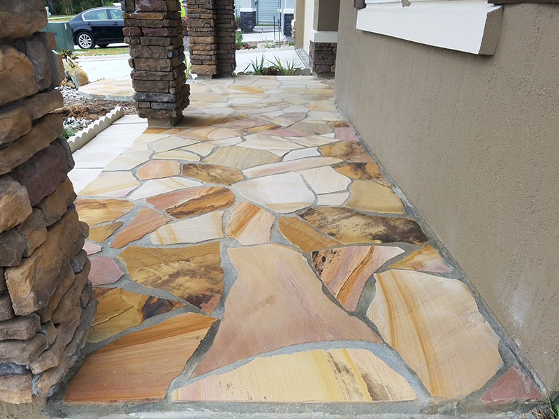 Natural stone walkway for residence