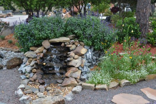 Small natural stone waterfall engineered by Earth Source Jax