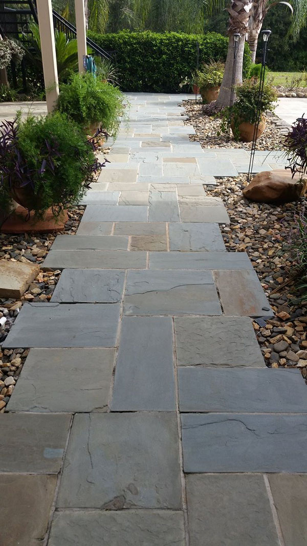Natural stone walkway using square flagstone